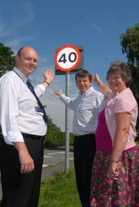 Cllr Eleanor Johnson (r) at one of the new speed signs.