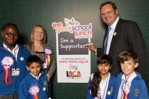 City of Chester MP, Stephen Mosley, who hosted the lunch on behalf of LACA, shows his support for the Great Free School Lunch with LACA Deputy Chair Carrieanne Bishop and pupils from Chase Side Primary School, Enfield, London.